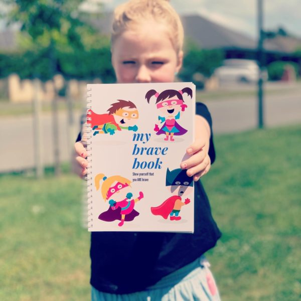 Grace holding My Brave Book
